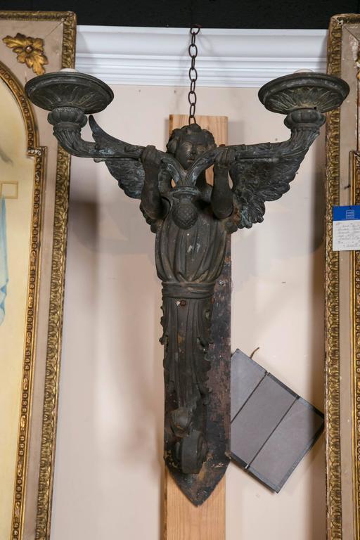 Exceptional bronze architectural putti form sconces, circa 1885. Still retain original gas pipery.