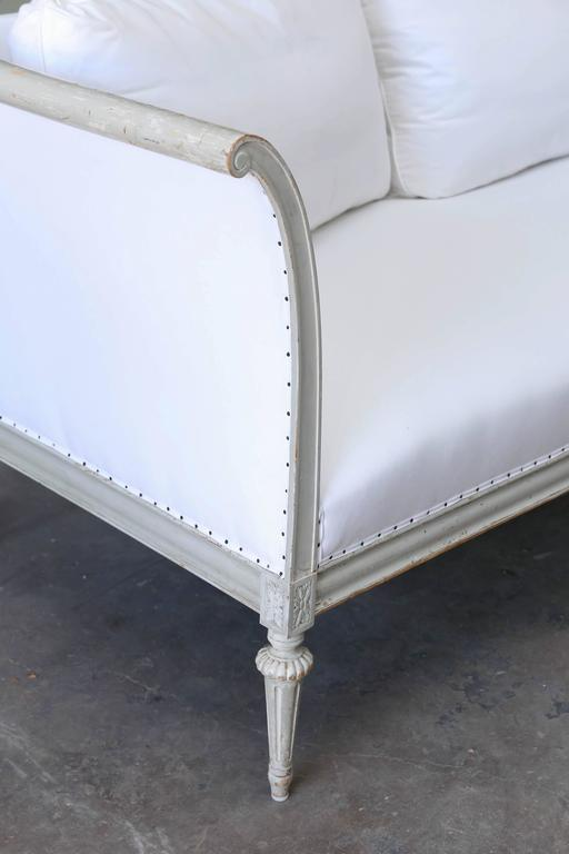 This is a lovely large Swedish Gustavian style sofa that has been upholstered in muslin.