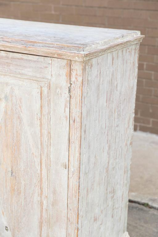 Swedish two-door buffet with typical Gustavian motif with three interior shelves.
