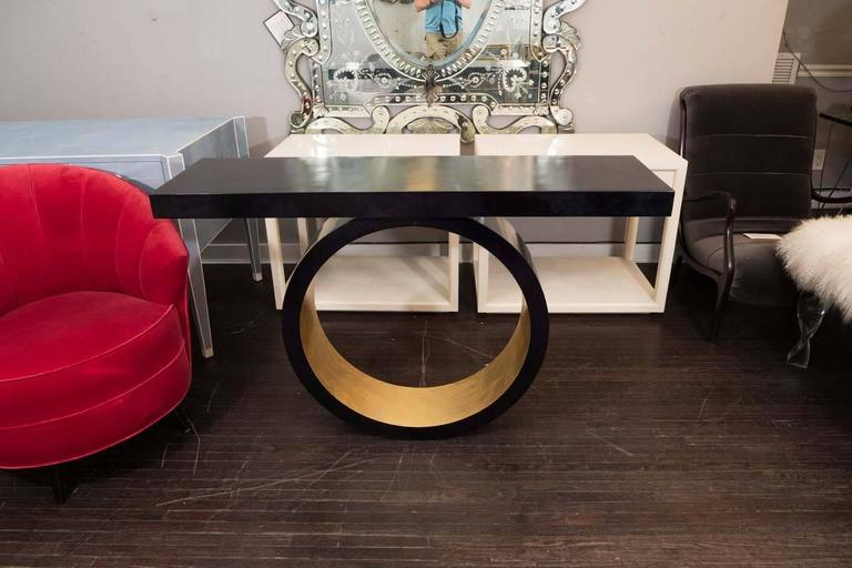 Custom black parchment wall-mounted circle console with gold leaf.