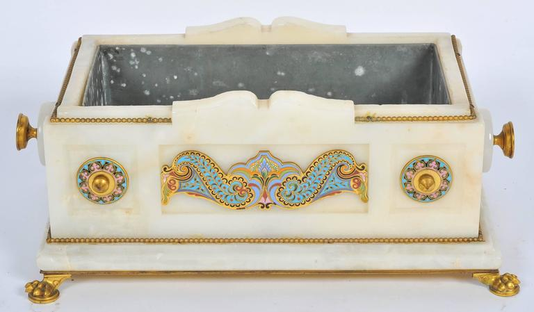 A very impressive and fine quality French 19th century marble and gilded ormolu jardinière with classical motifs each made of champlevé enamel, having a zinc liner and raised on gilded claw feet.