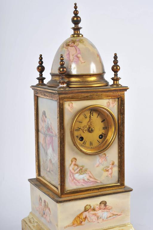 A good quality 19th century Vienna porcelain mantel clock. Each of the porcelain panels depicting classical scenes, set in gilded ormolu. The clock being an eight-day movement and chimes on the hour.