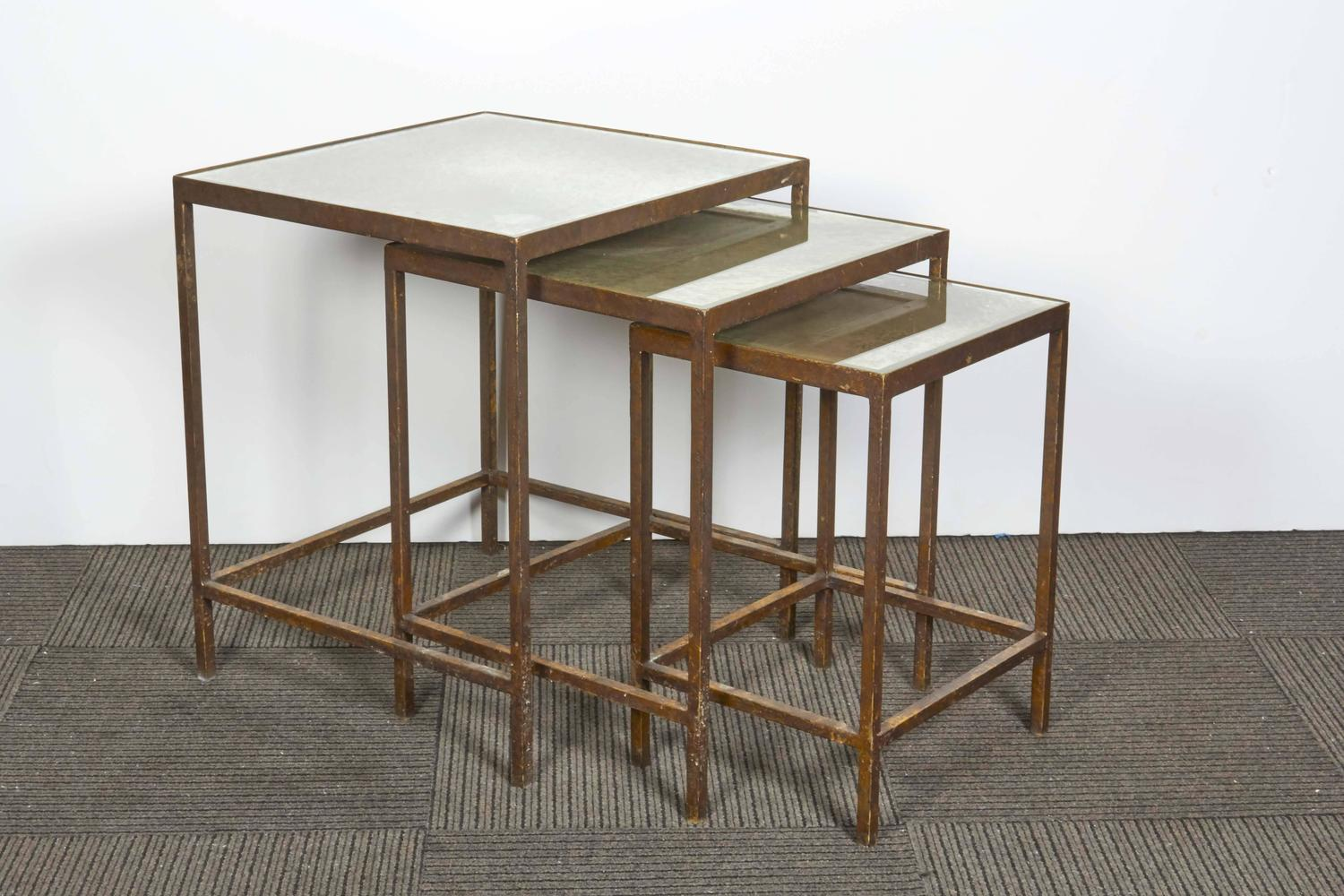 Set of three gilt metal nesting tables with mirrored tops