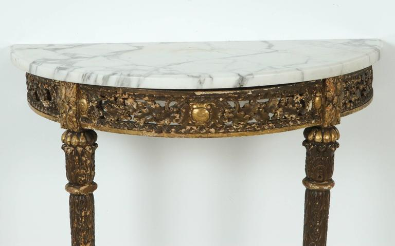 Charming petite demilune console table with white Carrara marble top.