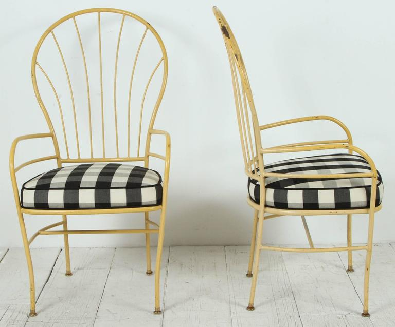 Charming yellow metal Windsor style chairs in new black and white gingham fabric.