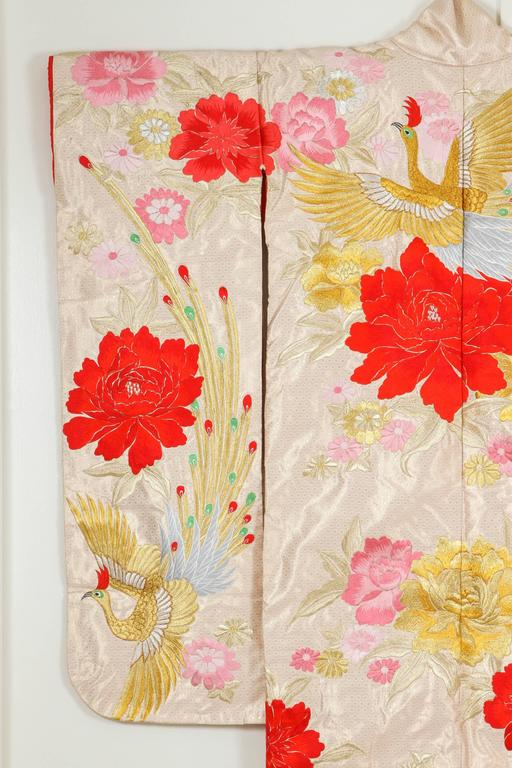 A vintage Mid-Century ivory color silk brocade collectable Japanese ceremonial kimono. One of a kind hand crafted. Fabulous museum quality ceremonial piece in pure silk with intricate detailed hand-embroidery throughout accented with floral gold