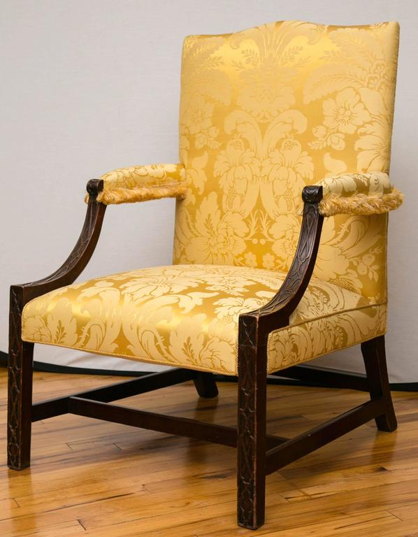 A mid-18th century George III period mahogany Gainsborough armchair, having set back filigree design arms supported on square legs with stretchers.