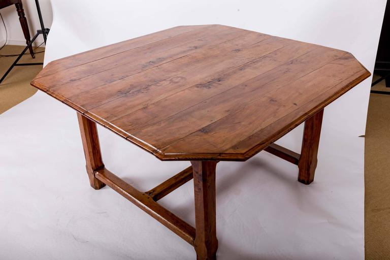 Square table with cantered corners, molded edge, one full length drawer with original turned knob, square cantered legs with cross stretching. Originally used vineyard tasting table from Bordeaux. Seats eight.