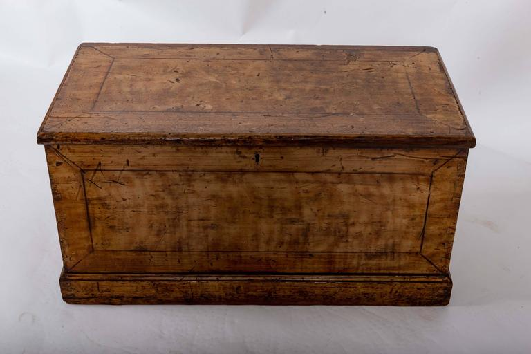 Original painted pine trunk with candled box inside and original iron carrying handles.