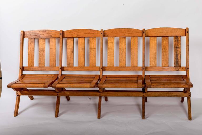 Folding oak railway car bench, slatted back and seat. Each seat folds back individually. Solid construction and deep comfortable seat.