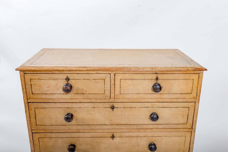 Original painted beechwood, three short drawers over three long, bracket feet and painted diamond-shaped escutcheons. Original green paint.