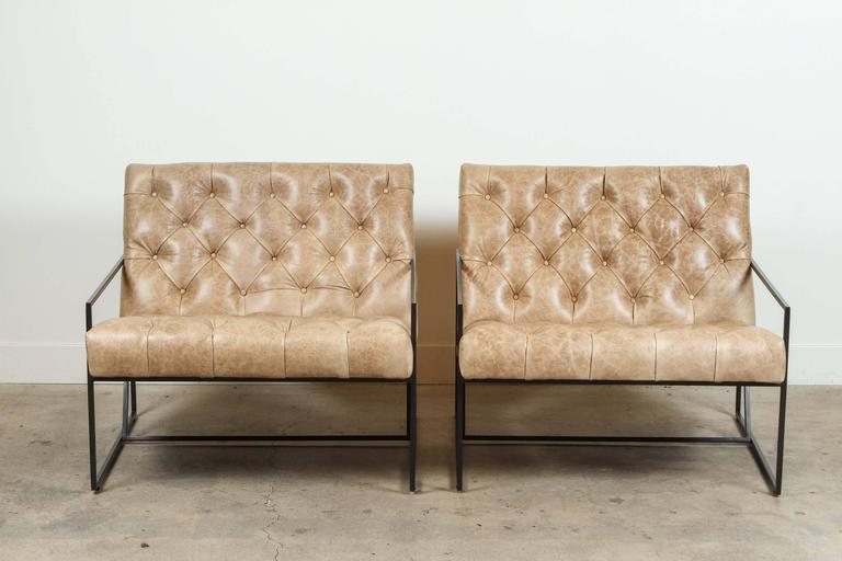 Pair of tufted thin frame lounge chairs by Lawson-Fenning in Vermont beige leather and matte black powder coat. Available to order in various finishes with a 8-10 week lead time.   As shown: $5,312 pair. Available individually.  To order: $3,800 +