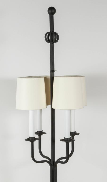 Tommi Parzinger mid-century iron floor lamp. Restored including new electrical and new custom shades.