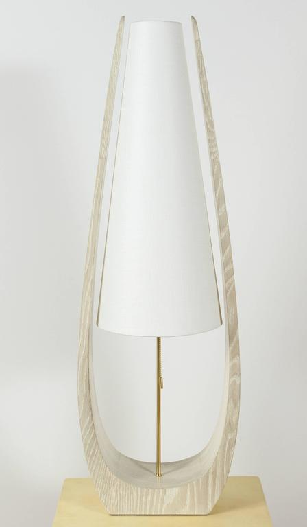 Modern, Mid-Century style 1970s inspired tall wishbone table lamp shown with  in gray cerused oak. Linen shades and brass hardware. By order.