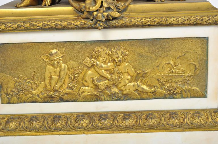 A very good quality, large French 19th century gilded ormolu and white marble mantel clock, signed; 'Monbro Aine, Paris'. Having an urn of grapes with semi clad Putti on either side. An enamelled dial, eight day chiming movement, an inset ormolu