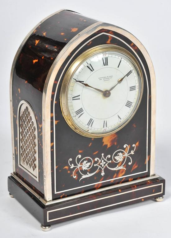 A fine quality English silver mounted and inlaid tortoiseshell mantel clock, in the Gothic style. 'Edwards & Sons 163 Regents Street, London.