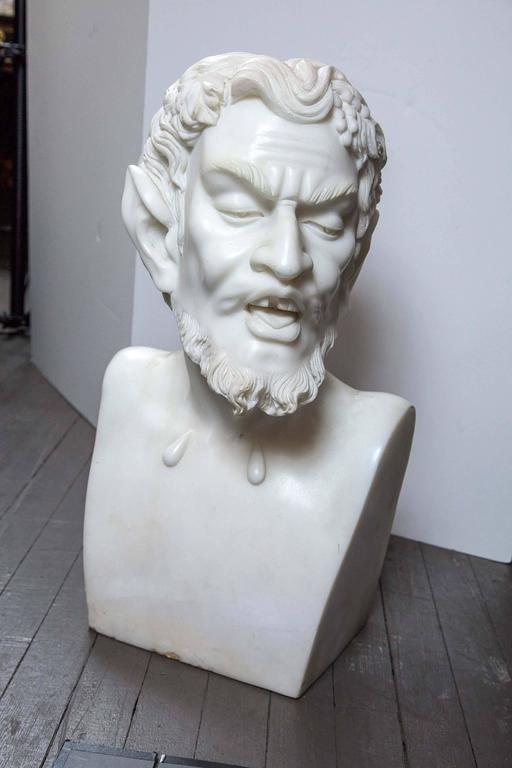 Just in time for Halloween, a well carved white marble bust of the Satyr, complete with pointed ears. Bunches of grapes and some grape leaves decorate his hair. The depth includes his bearded chin. He is very heavy.