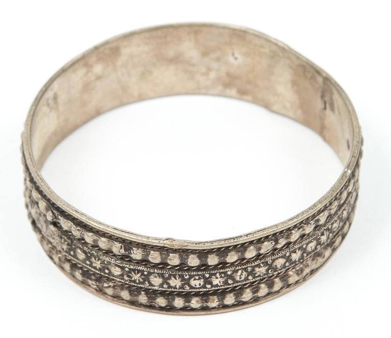 Moroccan tribal silver bracelet from the High Atlas of Morocco.  Handcrafted by Berber women using Moroccan silver nickel.  The ethnic Nomadic and Bedouin jewelry in the Maghreb and North Africa is usually made of silver and the designs are