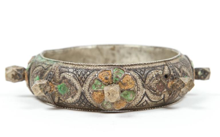 A 1920s handcrafted Ethnic bracelet by Berber women of Morocco. Women wear this kind of bracelet and silver jewelry for special ceremonies and wedding.  Silver, but not of the standard of sterling. Richly embellished with applied silver spikes and