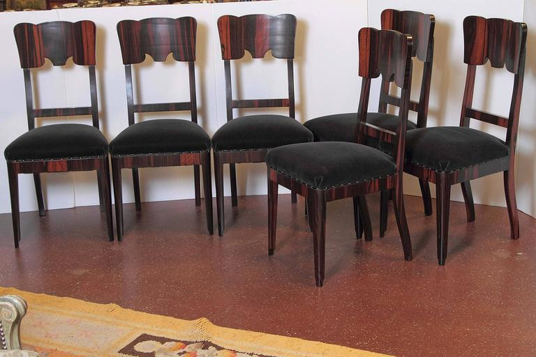 Set of six French Art Deco rosewood veneered side chairs.
