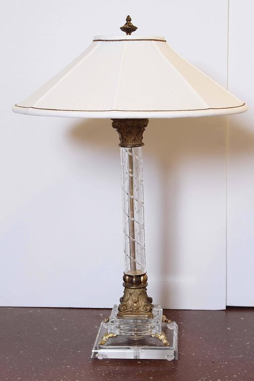Pair of cut crystal column lamps with bronze trim. Custom linen shades.