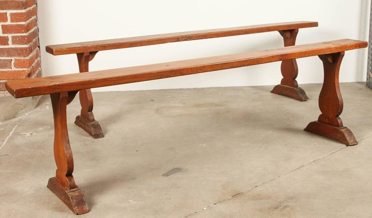 Rustic wood trestle bench.