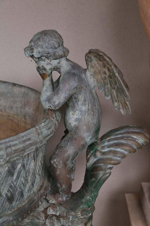 Pair of Verde Patinated Large Bronze Planters with Winged Cherubs and Garland In Good Condition In Houston, TX