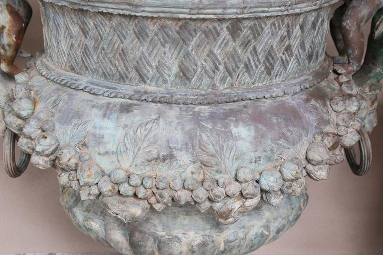 Pair of Verde Patinated Large Bronze Planters with Winged Cherubs and Garland 1