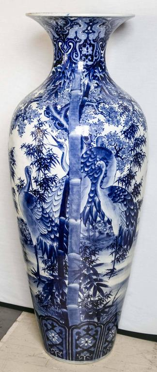 This vase has a tapered body with a flared neck. It is fully decorated with cranes, leaves, flowers and bamboo stalks. The flared neck opening is approximately 14 inches wide.   Shipping charges are estimates.