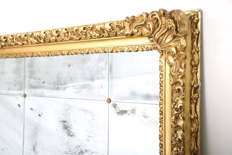 Magnificent And Palatial Wall Mirror In The Baroque Style Of Carved Giltwood Having