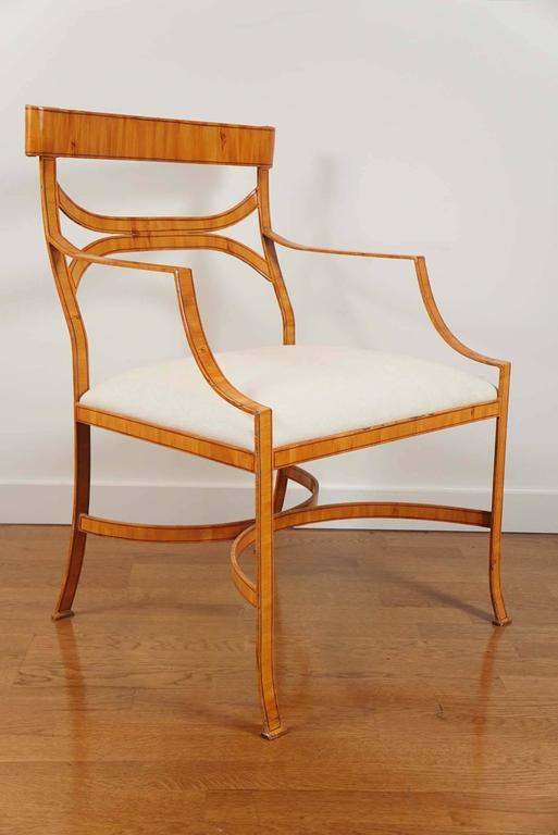 iron armchair with a faux bois finish. Newly upholstered seat cushion, on a stunning,
