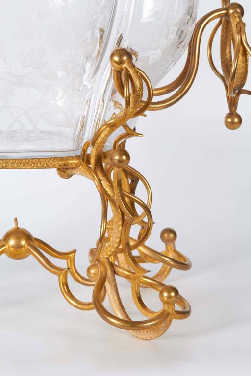 An unusual antique Baccarat crystal and Dore bronze-mounted oval shaped centrepiece, the removable oval shaped crystal bowl, beautifully hand-cut and engraved with floral and vine decoration, mounted in rope designed hand chiselled dore bronze