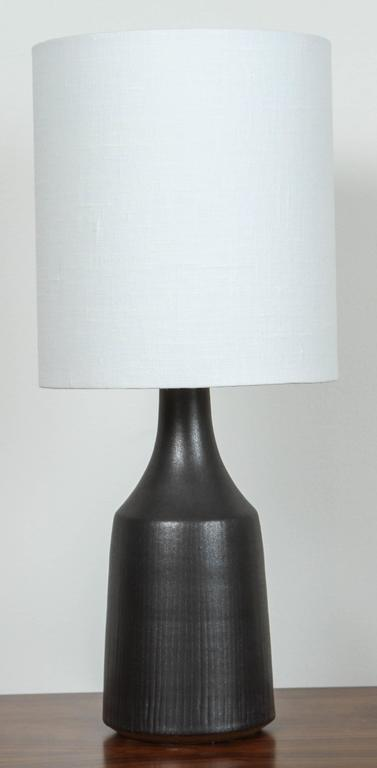 """Pair of black """"Classic"""" lamps by Victoria Morris."""