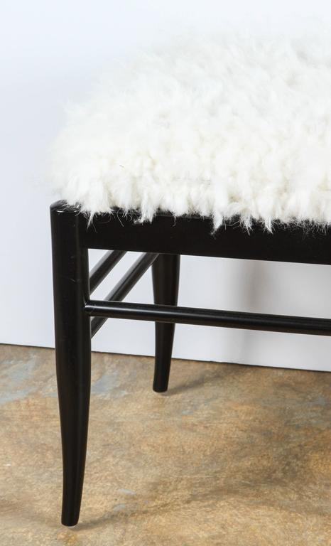 Contemporary Mid-Century Modern style bench inspired by Gio Ponti, upholstered in woven natural sheepskin from Denmark. By order only.