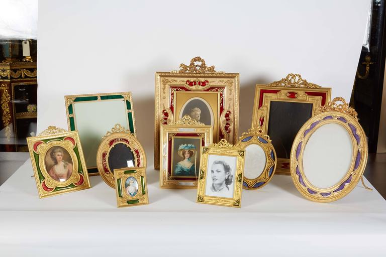 A large French gilt bronze ormolu and red guilloche enamel picture photo frame, 19th century.  Frame size: 18 x 13 inches. Photo size: 9 x 8 inches.