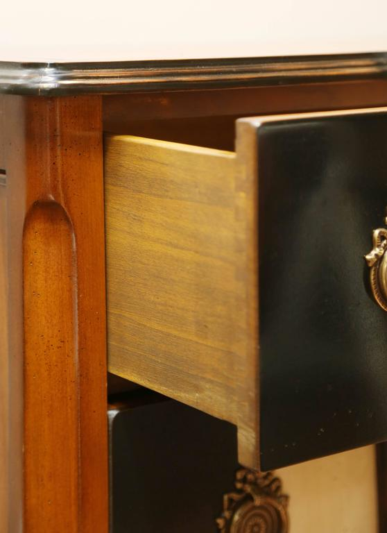 Handsome two-drawer Louis XV style chest. Both drawers are accented with an antique white and black stripe.