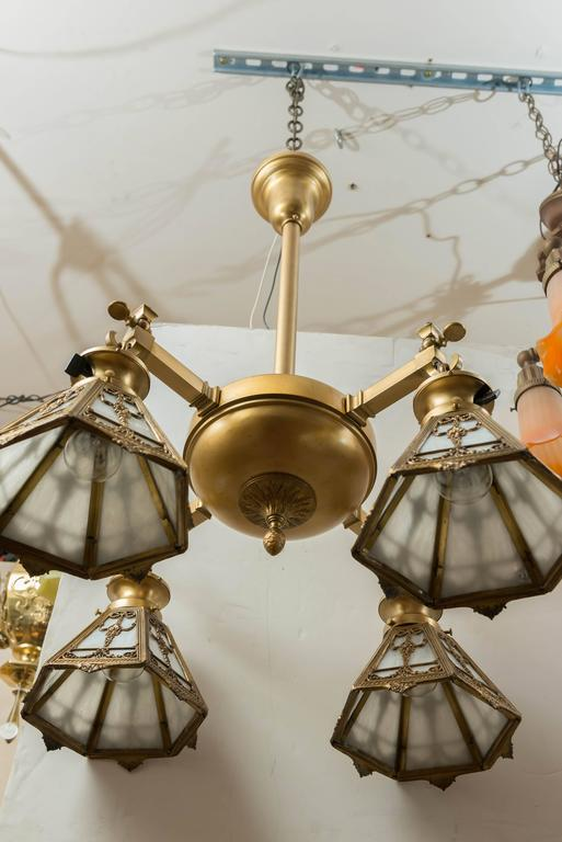 Early 20th Century Four-Arm Gilt Bronze Chandelier with Signed, Bradley & Hubbard Shades For Sale
