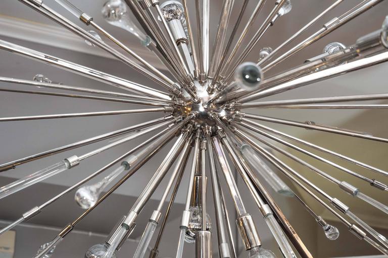 Polished nickel teardrop chandelier.
