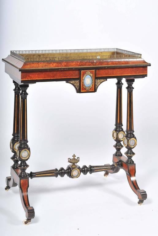 A good quality English 19th century amboyna, ormolu-mounted floor standing jardiniere with wedgwood plaques.