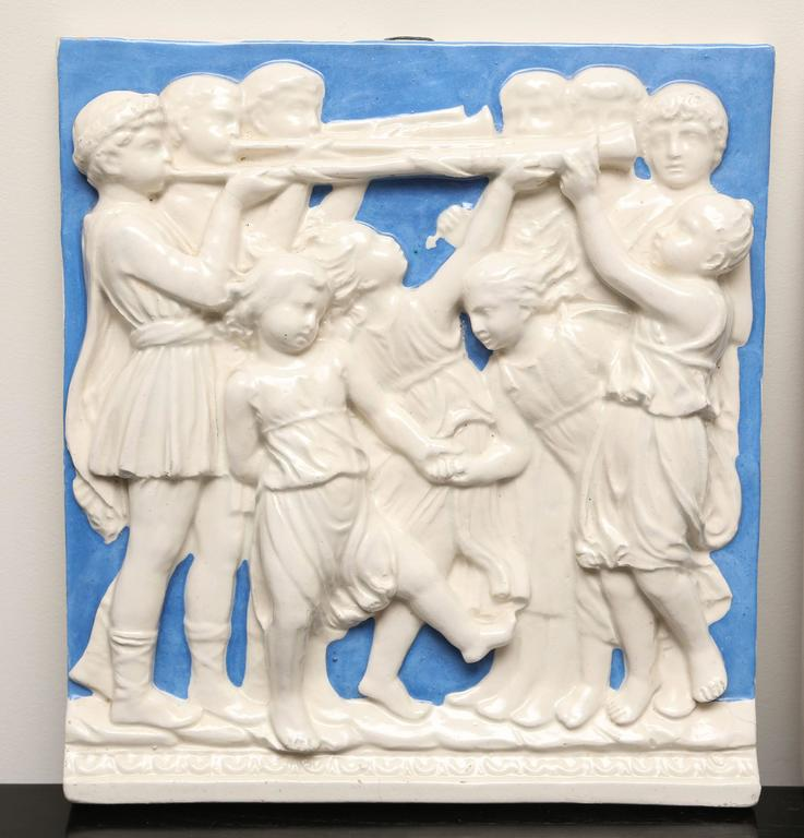 Charming pair of Romanesque type plaques featuring gentlemen, maidens and children.