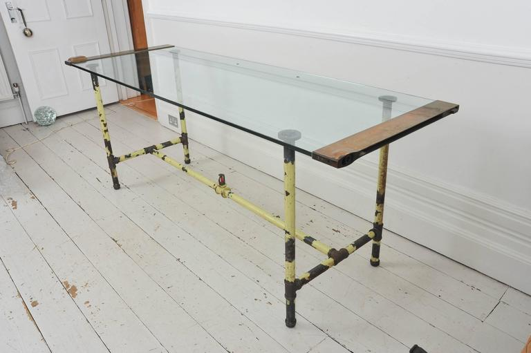A Glass Brass And Steel Table Recycled From Original