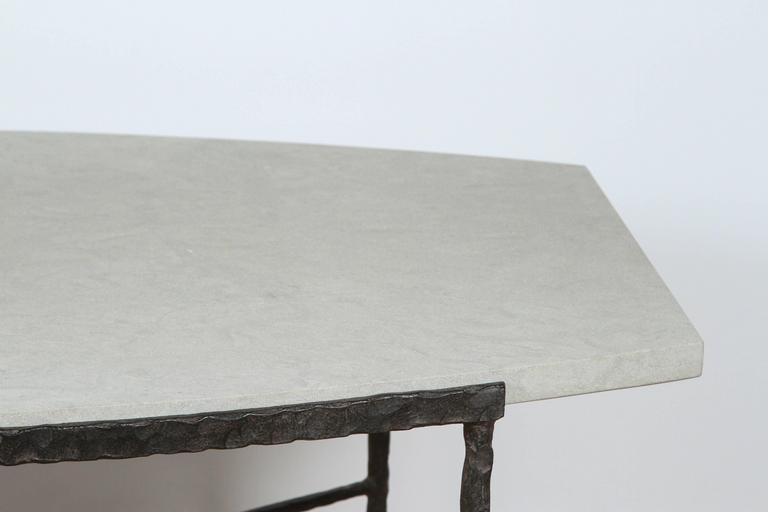American Paul Marra Ellipse Cocktail Table in Textured Iron and Bateig Blue Stone For Sale