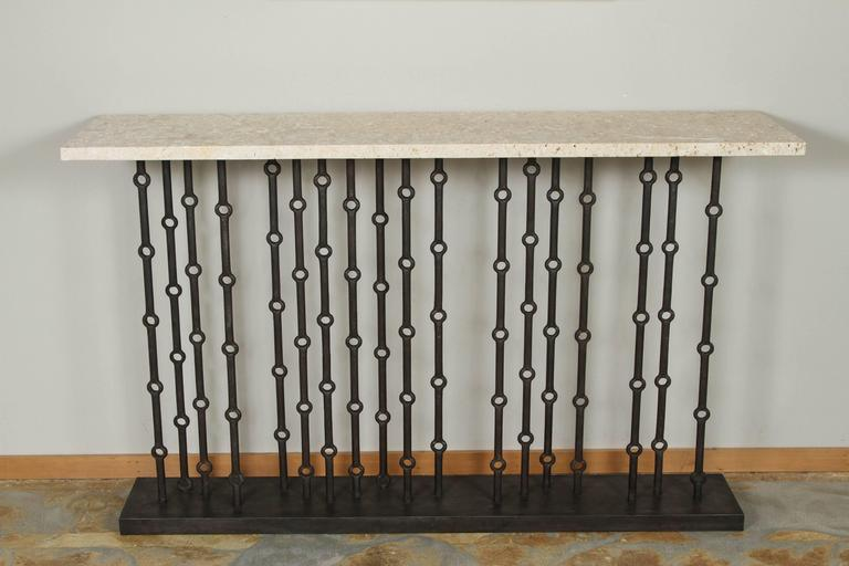 Paul Marra Iron Console with coral stone top. Modern, sculptural Brutalist console referencing Mid-Century design. By order.  Note that the stone has natural imperfections indicative of the material.