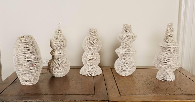 Each of the lanterns a unique form and made of hand-scrolled unglazed white terra cotta. This is the last set from the limited edition of 3 designed by Lucio Romero of prototype zero in collaboration with Piero di Terlizzi. Can also be sold as a set