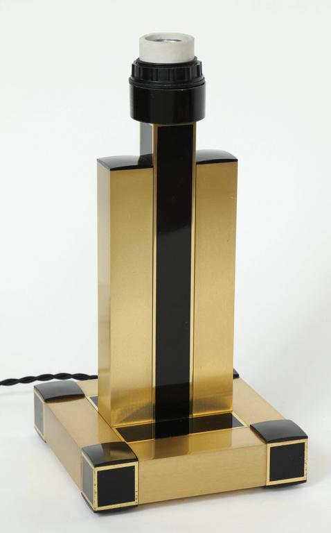 Chic pair of 1970s brushed brass modern table lamps with black resin accents. Rewired for USA with black silk twist cording.
