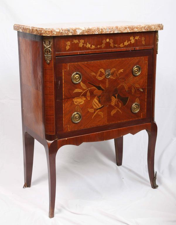 Exquisitely inlaid, with nice proportions and marble top.