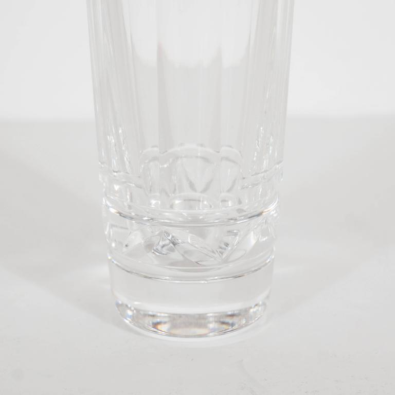 Ten crystal shot glasses with ten