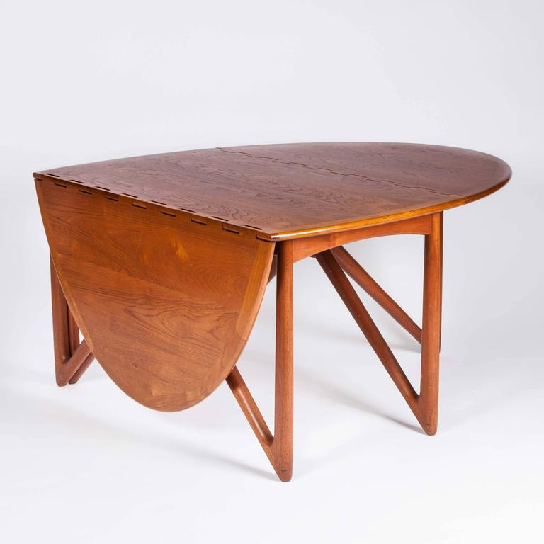 Teak drop-leaf dining table by designed by Kurt Østervig and made by Jason Møbler, circa 1955. 