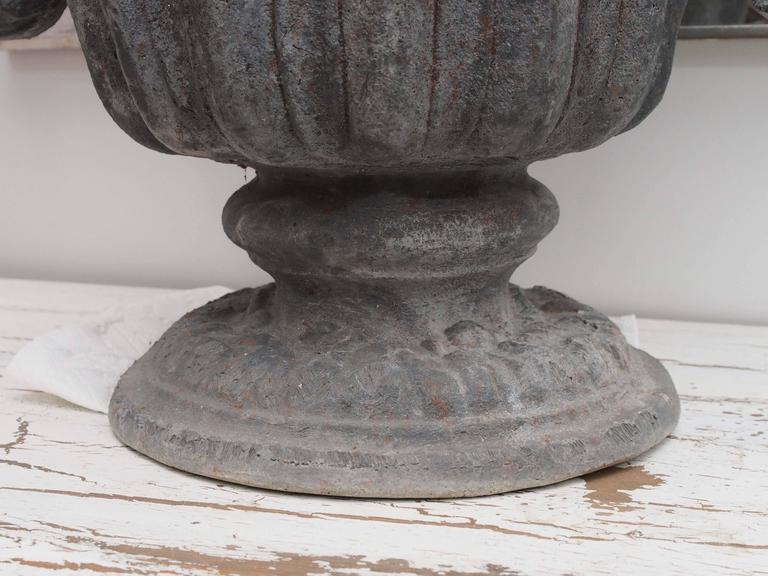 Set of Four Lead Urns with Cherubs 5