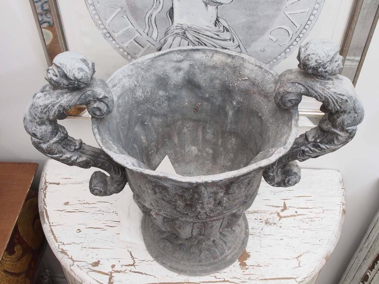 Set of Four Lead Urns with Cherubs 6